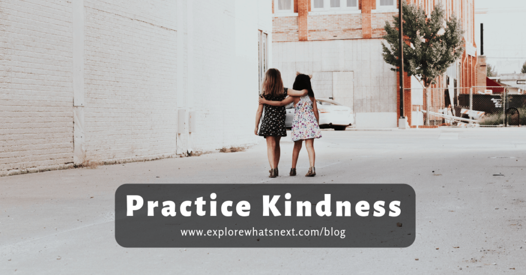 text reads practice kindness and shows two children walking with arms around each other in kindness